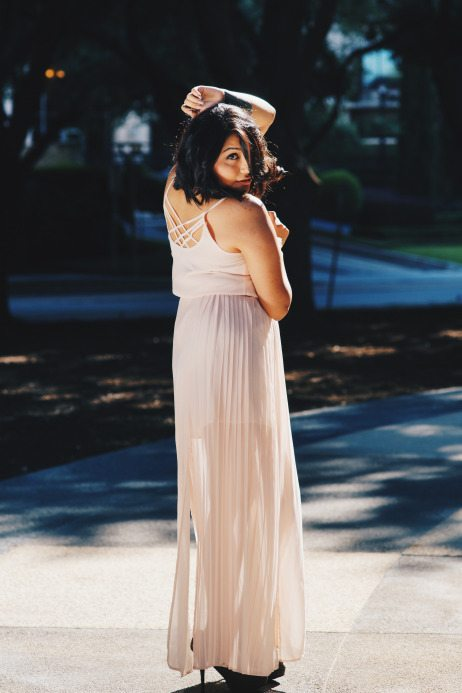 Mayra a la Mode fashion blogger featured for Think Elysian Boutique in pleated chiffon maxi dress with back detail // www.thinkelysian.com