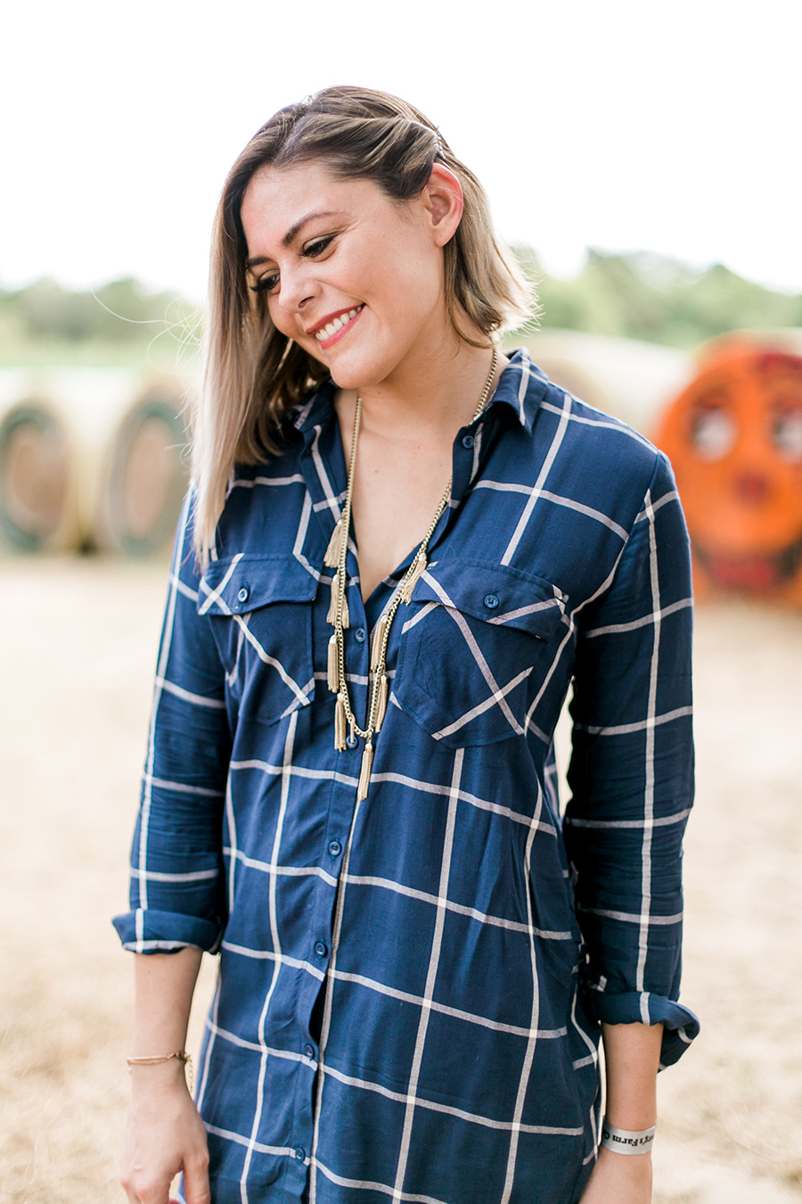 Fall fashion: plaid tunic with gold tassel necklace & Toms wedges // thinkelysian.com